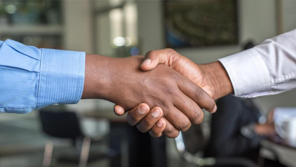people shaking hands after closing a sale